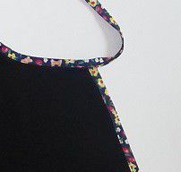 Apron tied - black with colorful piping